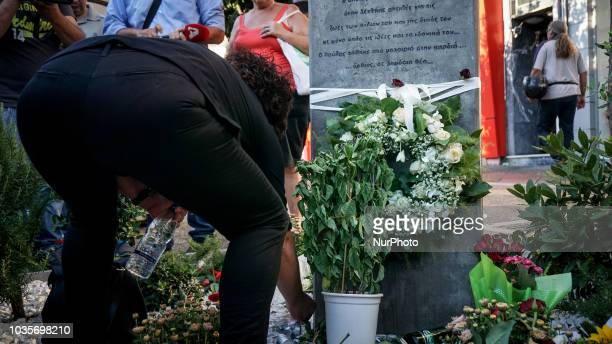 Mother of Pavlos lights a candle during the 5th anniversary of the murder of Pavlos Fyssas in Keratsini September 2018 September 2018 marks 5 years...