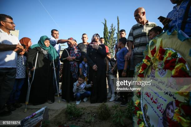 Mother of Rezzan enNeccar a Palestinian volunteer paramedic killed by Israeli forces Sabrin enNeccar visits her daughter's grave after Eid alFitr...