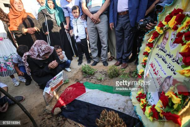 Mother of Rezzan enNeccar a Palestinian volunteer paramedic killed by Israeli forces Sabrin enNeccar prays around her daughter's grave after Eid...