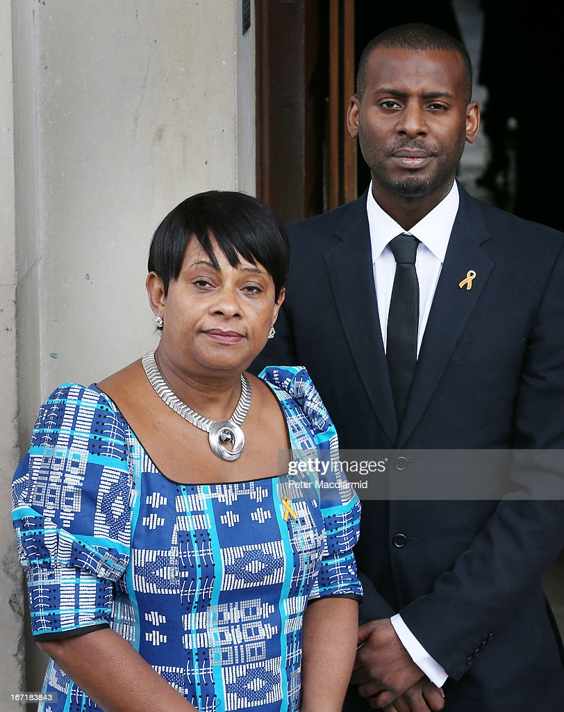 Mother of Stephen Lawrence, Doreen Lawrence stands with her son Stuart Lawrence at a memorial service for her son Stephen at St Martin-in-the-Fields Church on April 22, 2013 in London, England. Stephen Lawrence, a black A-level student was stabbed to death at a bus stop twenty years ago by a gang of white youths in a racially motivated attack in Eltham, south-east London, on April 22, 1993. Two men, Gary Dobson and David Norris were found guilty of his murder in January 2012.