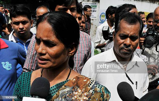 Mother of the 23yearold victim of December 16 gang rape arrives at Juvenile court on August 31 2013 in New Delhi India An Indian court found a...