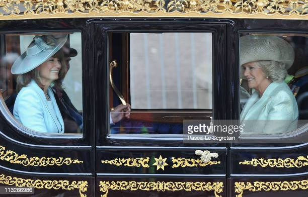 Mother of the Bride Carole Middleton and Camilla Duchess of Cornwall make the journey by carriage procession to Buckingham Palace after the Royal...