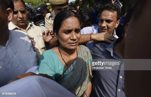 Mother of the victim coming out of the Supreme Court after the court pronounced verdict on the appeals filed by four death row convicts against death...