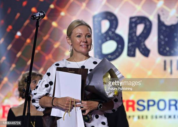 KYIV UKRAINE MARCH 9 2020 Mother of twotime world judo champion Daria Bilodid Svitlana Kuznietsova accepts the Best Coach of the Year award during...