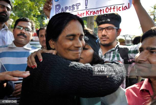 Mother of victim of December 16 gang rape hugs one of the protesters against gang rape after Delhi High Court today confirmed the death sentence for...