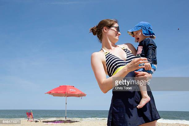 Mother on beach with toddler