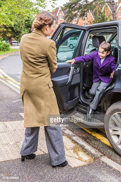 mother on school run, opening car door for son - getting out stock pictures, royalty-free photos & images
