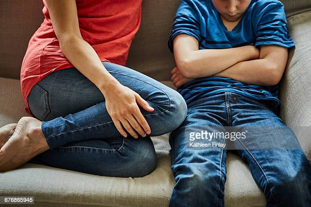 mother on sofa scolding son - stubborn stock pictures, royalty-free photos & images