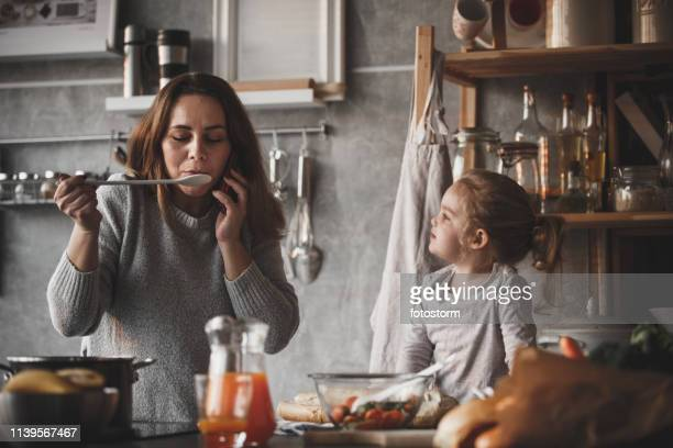 mother on the phone, cooking - domestic kitchen stock pictures, royalty-free photos & images