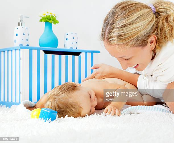 Mother pampering her baby girl daughter after bath