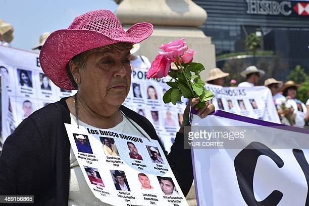 A mother participates in the March of Dignity promoted by International Amnesty in the framework of the Mother's Day in Mexico City on May 10 2014...