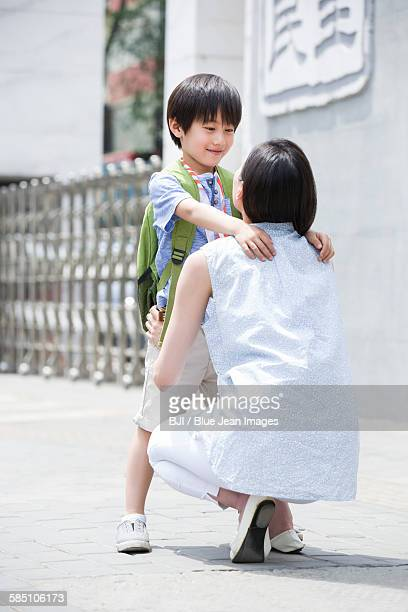 Mother picking her son up from school