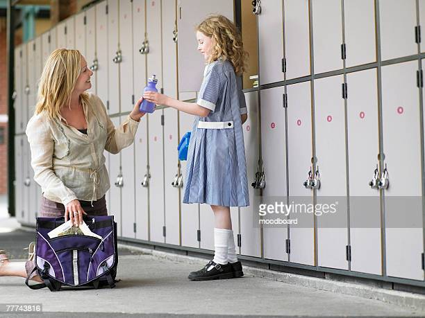 Mother Picking Up Daughter From School