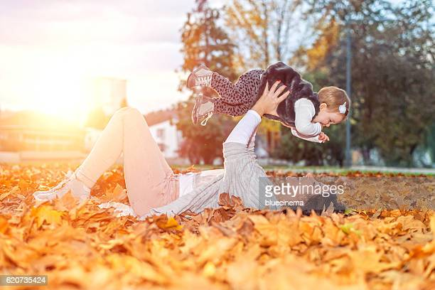 Mother play with daughter outdoor at park