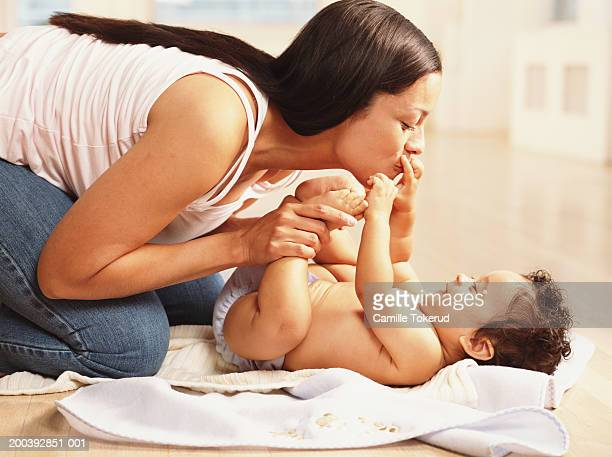 mother playing with baby boy (9-12 months), side view - 12 23 months stock pictures, royalty-free photos & images