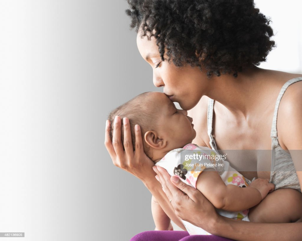 Mother playing with baby indoors : Stock Photo