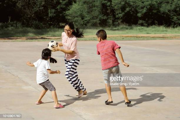 Mother Playing With Children At Park