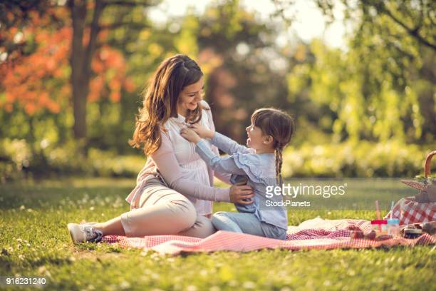 Mother playing with daughter in nature