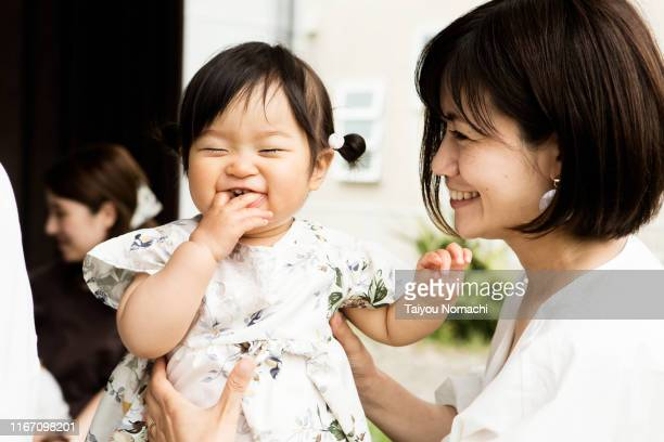 mother playing with her 1 year old daughter - japan stock pictures, royalty-free photos & images