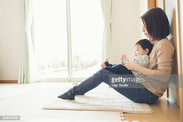 Mother playing with her baby girl at home