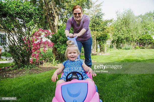 mother playing with her daughter (12-23 months) in garden - 12 23 months stock pictures, royalty-free photos & images