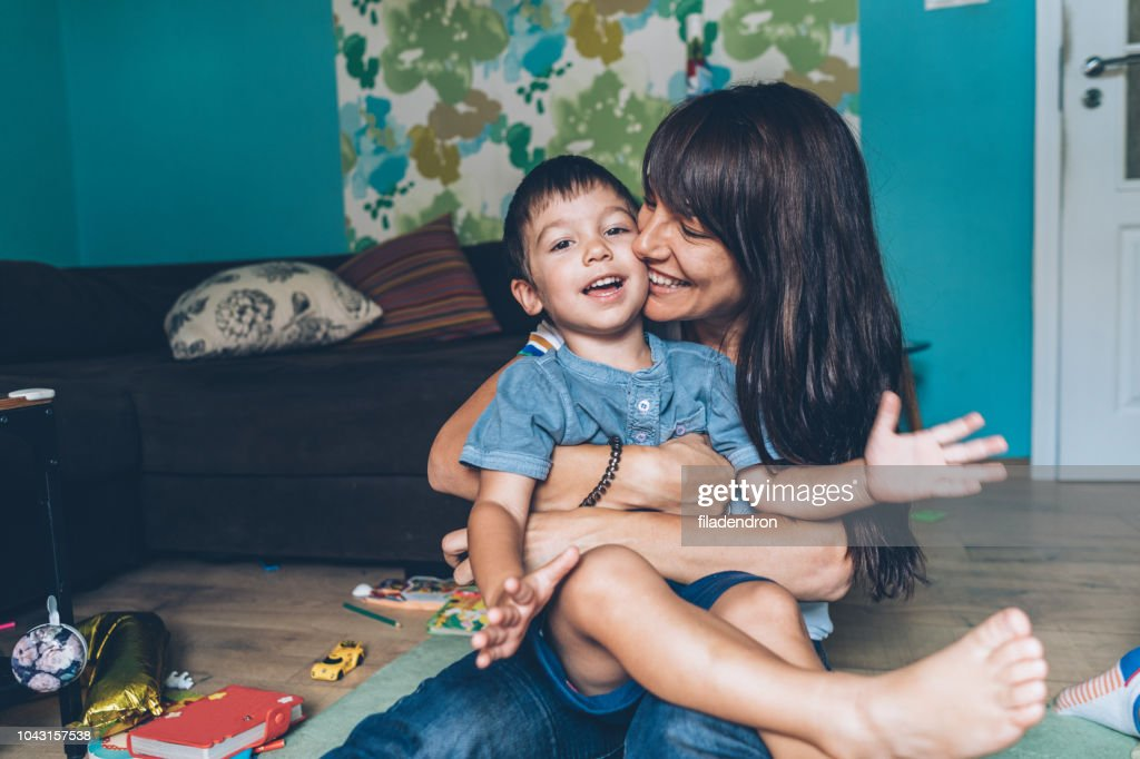Mother playing with her little son : Stock Photo