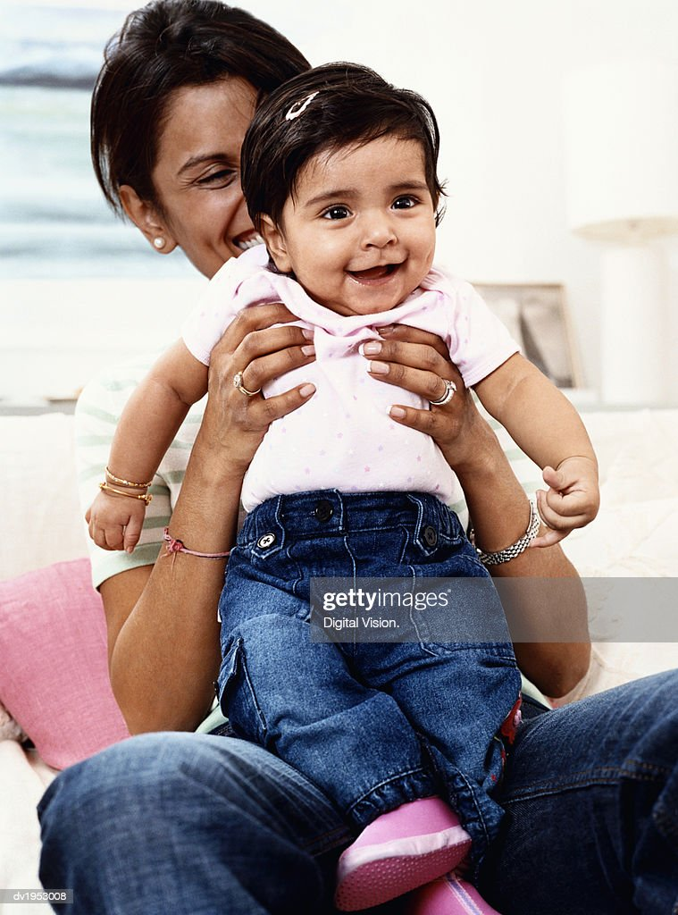 Mother Playing With Her Offspring : Stock Photo