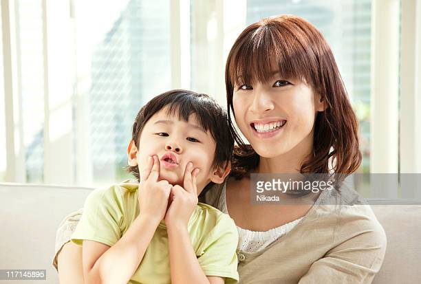 mother playing with her son - japan mom and son stock photos and pictures