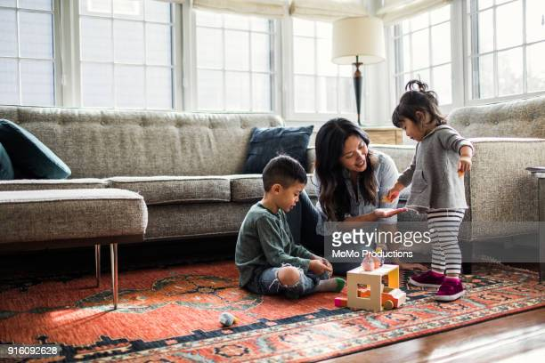 Mother playing with kids at home