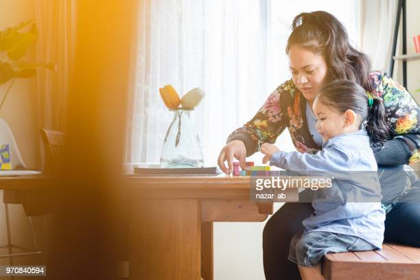 Mother playing with kids at home.