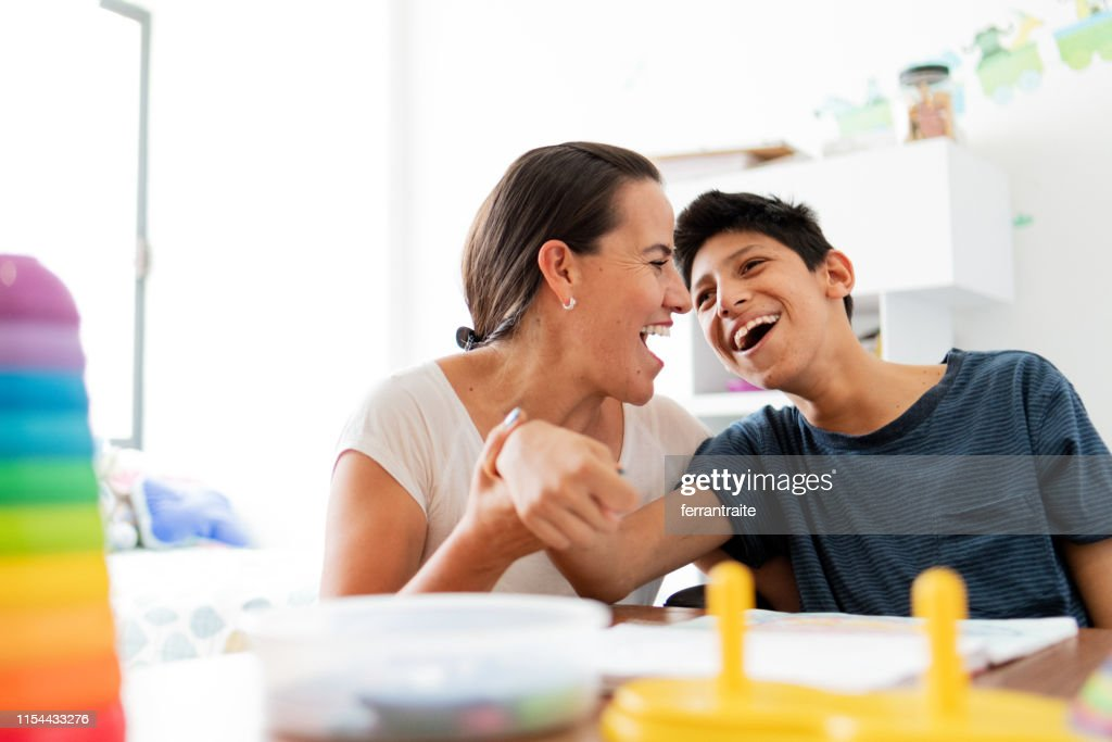 Mother playing with son with Cerebral Palsy : Stock Photo