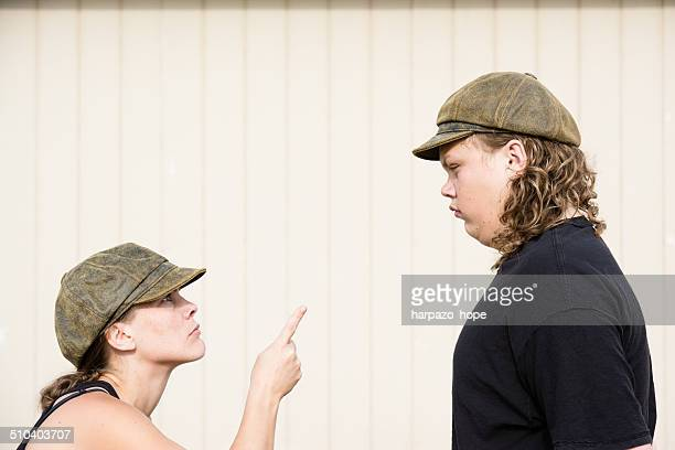Mother pointing to her teenage son