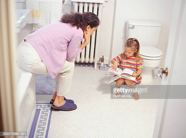 Mother potty training daughter (2-3), elevated view