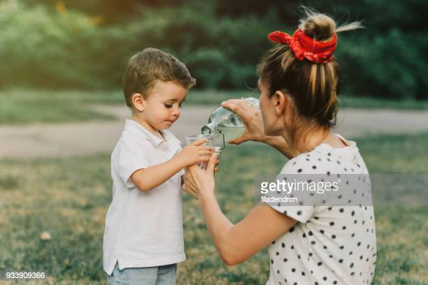 Mother pouring her child some lemonade