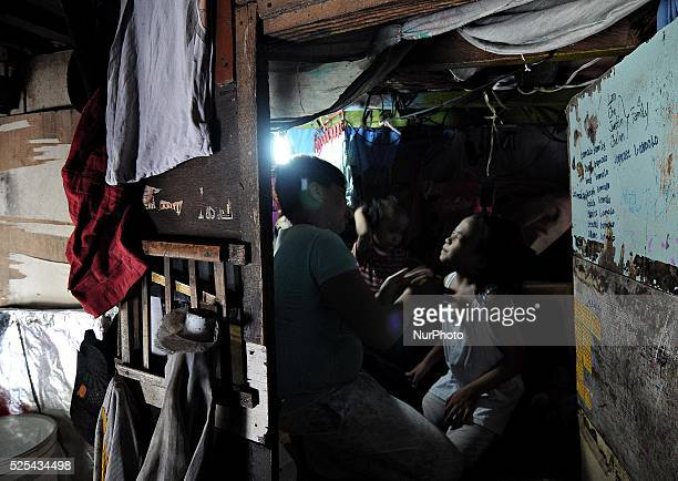 A mother prepares her daughter for school inside their makeshift home under a busy bridge in Quezon city suburban Manila Philippines July 30 2013...