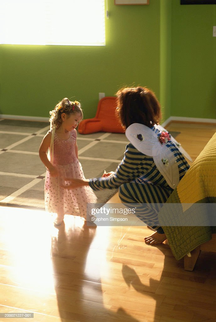 Mother preparing daughter (2-4) for dance class : Stock Photo