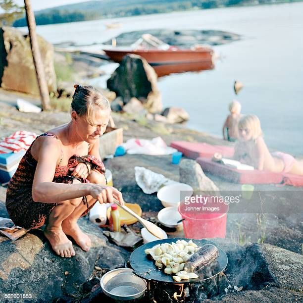 Mother preparing food at water