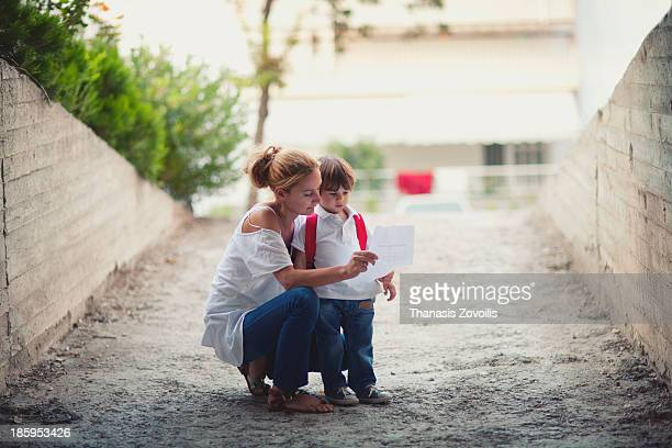 Mother preparing her son for school