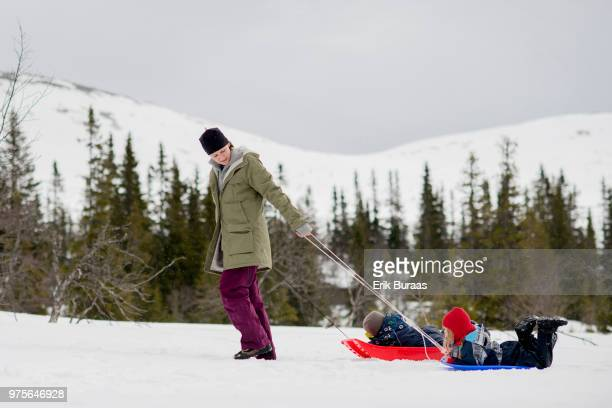 Mother pulling a sledge