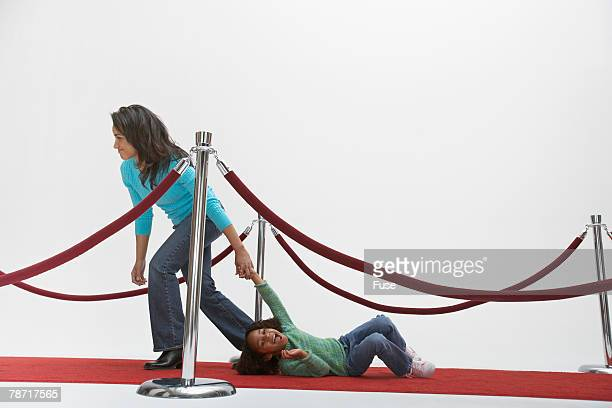 mother pulling daughter - dragging stock pictures, royalty-free photos & images