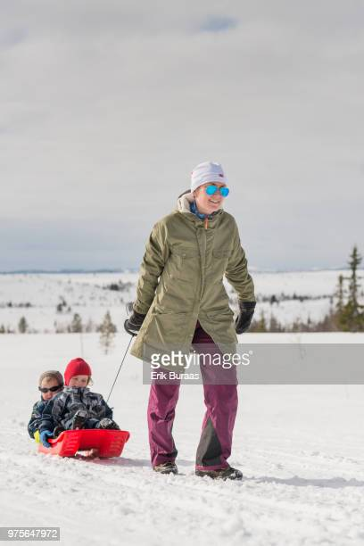 Mother pulling two sledges