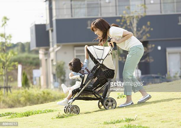 Mother pushing baby buggy
