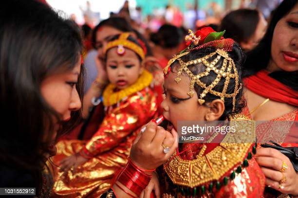 A mother puts make up on her daughter during the celebration of Kumari puja at Basantapur Durbar Square Katmandu Nepal on Tuesday September 11 2018...