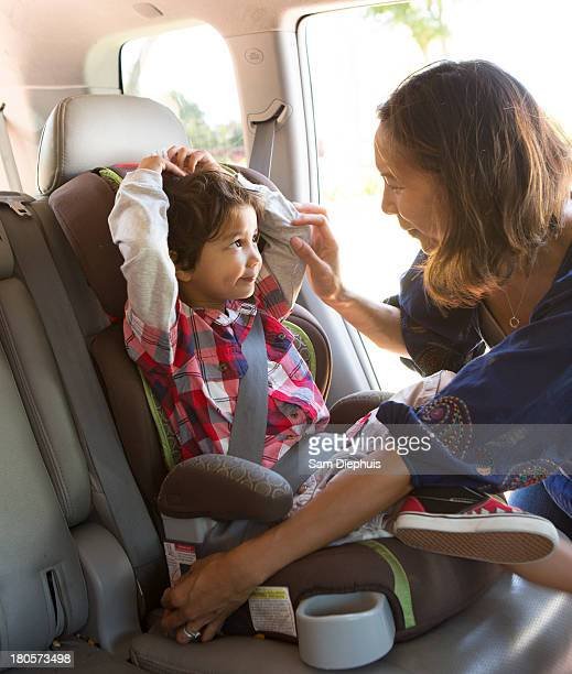 Mother Putting On Son's Seatbelt