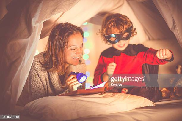 Mother reading a story to her son at bedtime