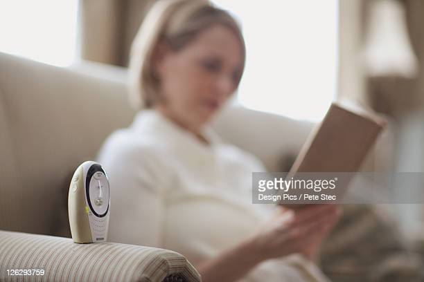 mother reading by baby monitor