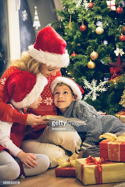Mother Reading Christmas Story To Children