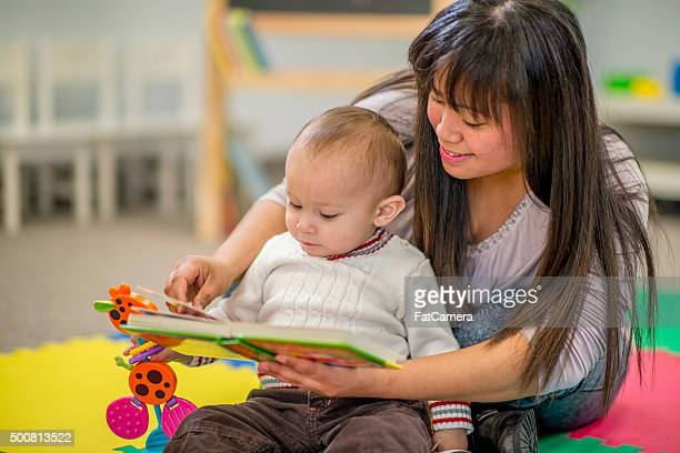 Mother Reading Her Son a Book