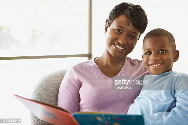 Mother reading stories to her son
