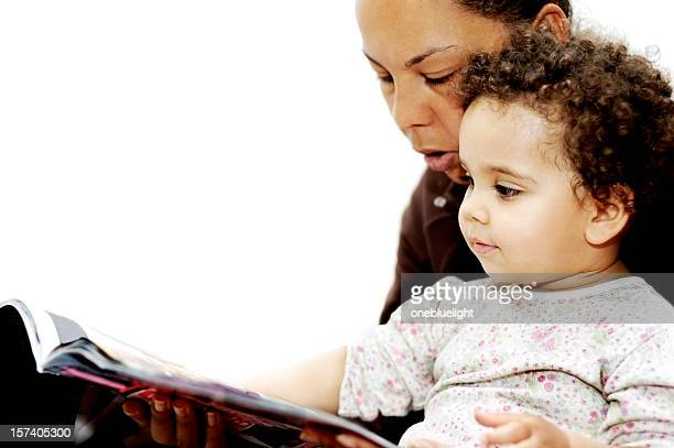 mother reading story to her baby girl - mixed magazine stock photos and pictures